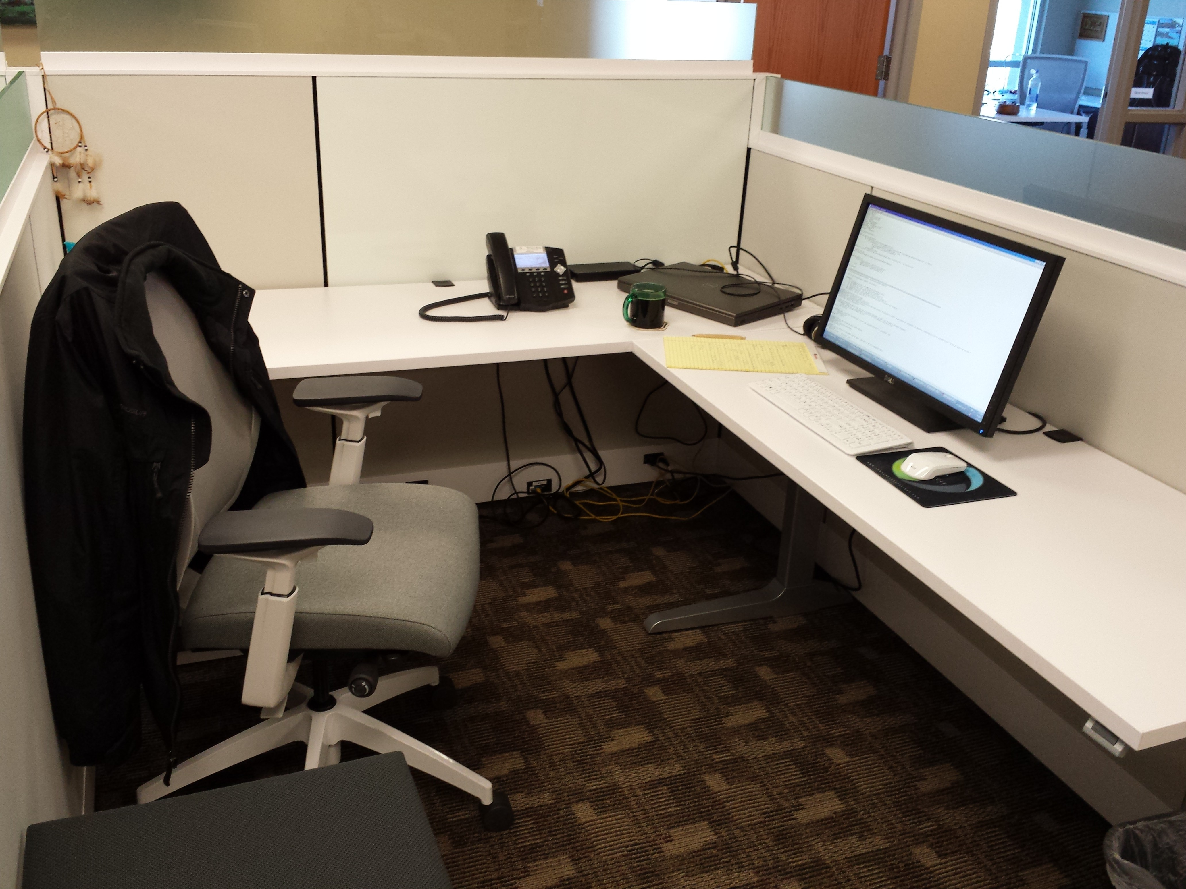My cubicle at my new office at Newscycle Solutions.
