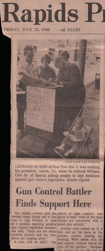 Dad signing a petition against the Gun Control Act of 1968. The Grand Rapids Press photographer didn't believe he was my father and insisted and crediting me as his grandson.